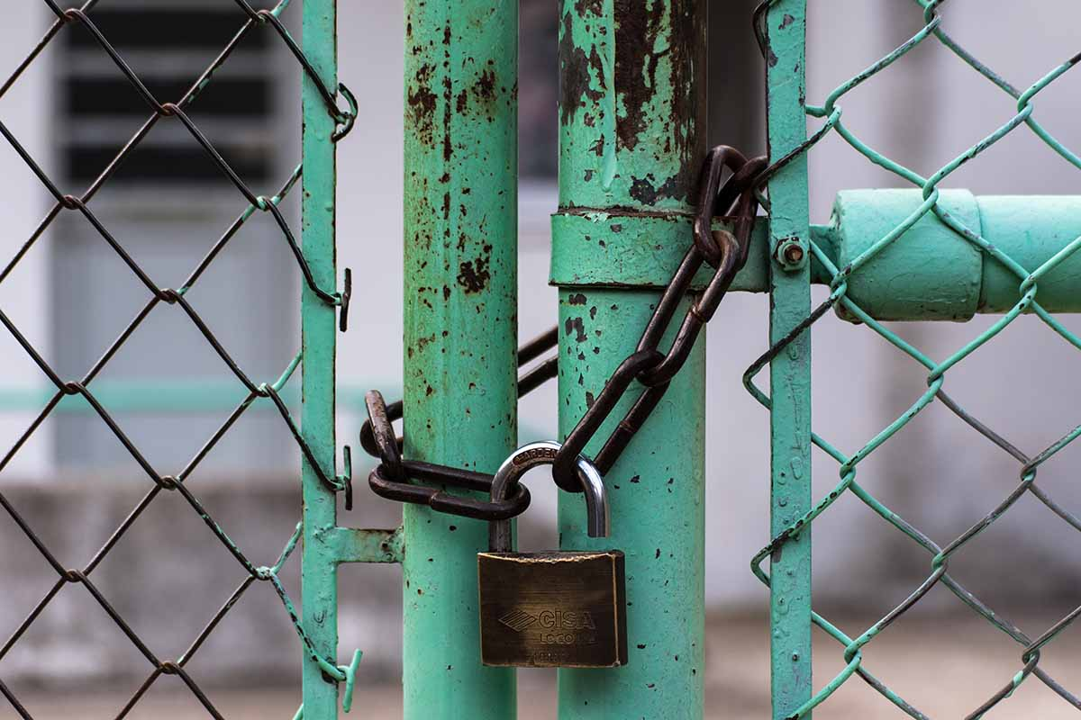 my body - close up image of a rusted gate with a pad lock on it