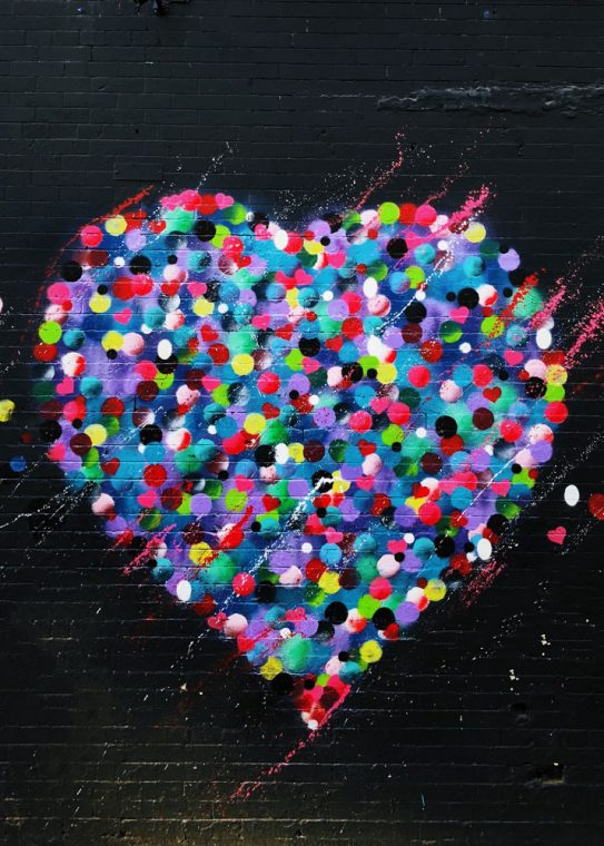 own valentine - image is black background with dots in various shapes and colors that make up a heart