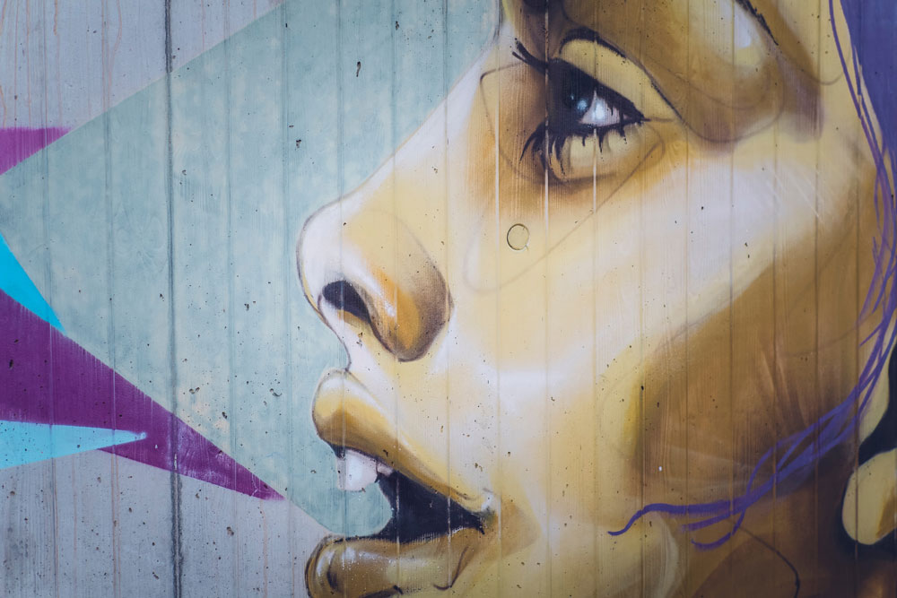 food rules - artistic art - profile of woman's face with mouth open, purple triangles in background; looks like graffiti on a wall