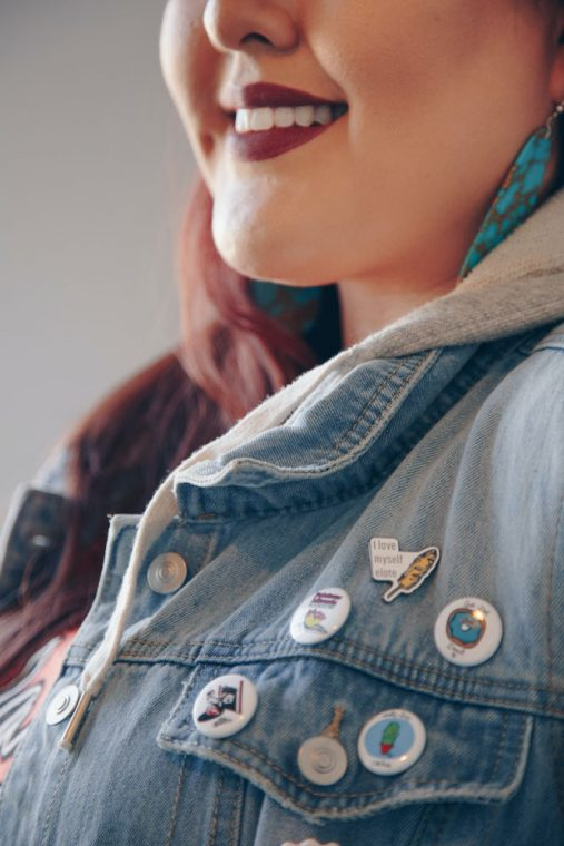 target weight - close up image of female face, showing from her nose down to her shoulders, she is smiling with lipstick on and wearing a denim jacket